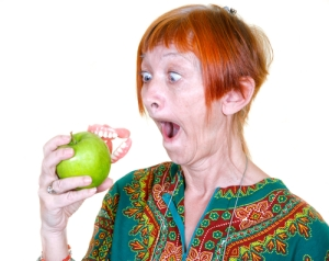 Dentures on an apple