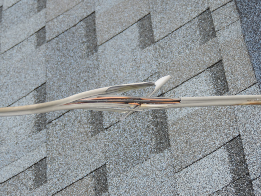 Damage to wire above Kars For Kids office