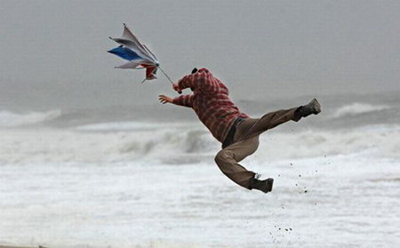Hurricane force winds blast a walker off his feet on Bournemouth beach, on March 10 Picture: BNPS