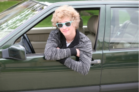 Cool teen hangs out car window