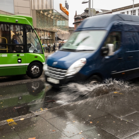 Van drives through puddle