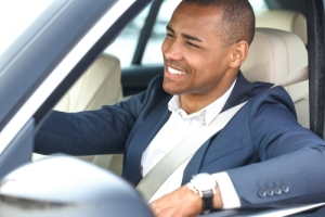 Hot uncomfortable African American driver discovers remote Driving mode that turns on AC