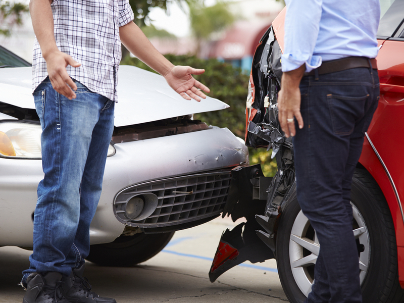 two drivers argue after car accident dented fender