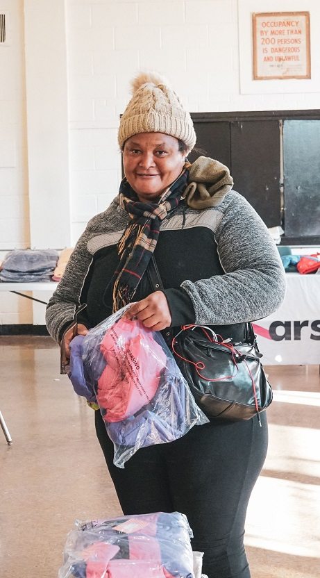 Smiling participant at MLK Far Rockaway Winter Wear Distribution 2020